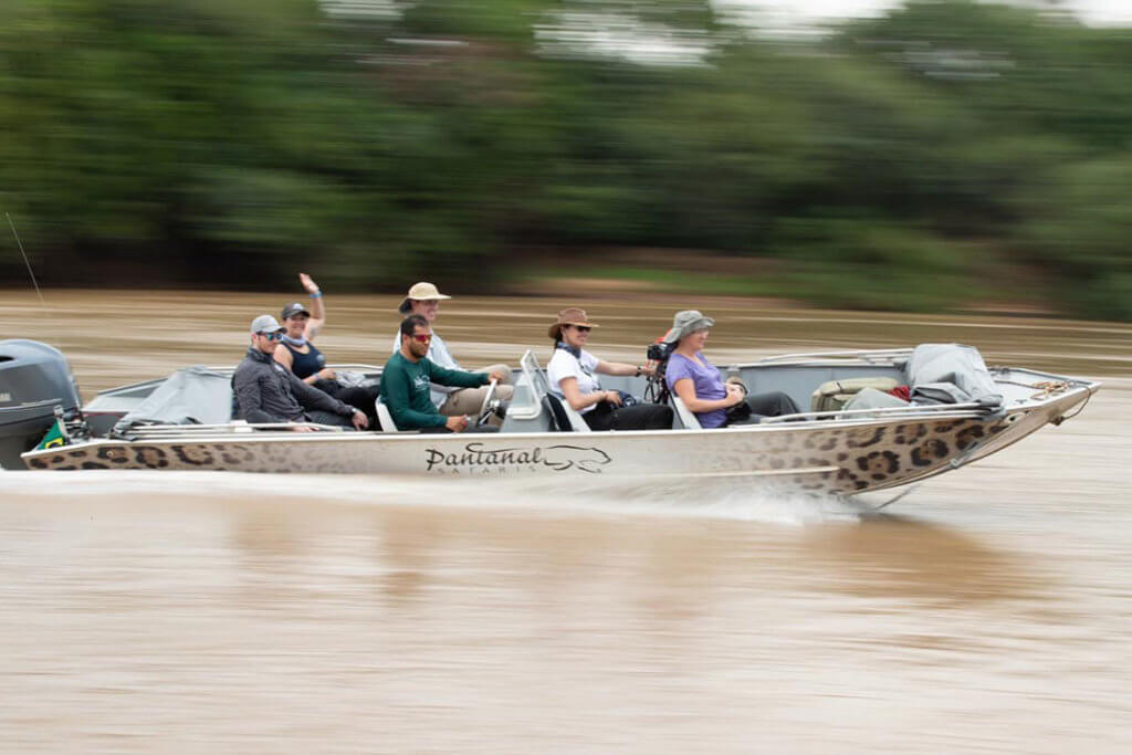 Boat with clients on a jaguar safari